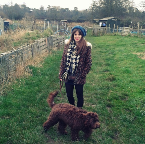 Here I am with Teddy, wearing as few layers as possible in British winter.