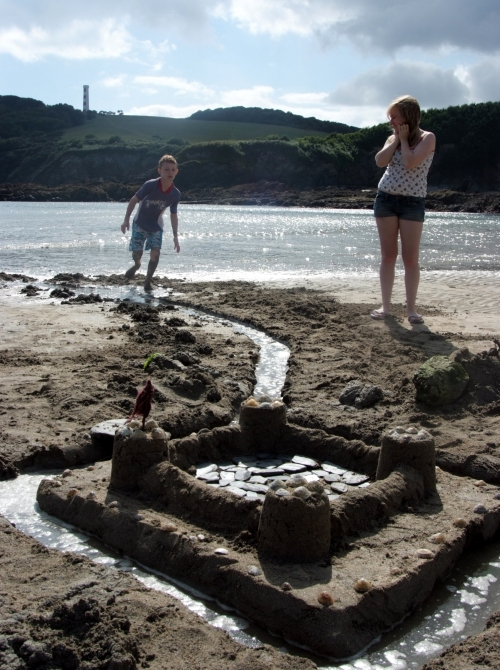 This kid thought our sandcastle was so awesome he helped dig the moat.